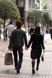 Young couple shopping. Young couple walking in a urban shopping area Royalty Free Stock Images