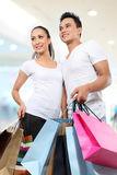 Young couple shopping. Romantic young couple shopping in the mall with many shopping bags Royalty Free Stock Image