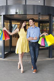 Young couple after shopping Royalty Free Stock Photo