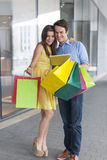 Young couple after shopping Stock Images