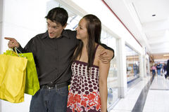 Young couple shopping. Medium shot of young couple shopping in mall Stock Photography
