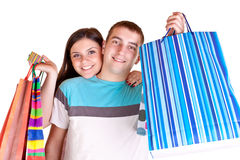 Young couple with shopping bags Royalty Free Stock Photography