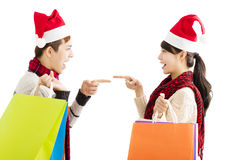 Young couple with shopping bags for christmas holiday. Happy young couple with shopping bags for christmas holiday Royalty Free Stock Photo