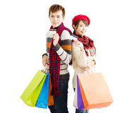 Young couple with shopping bags and credit card Royalty Free Stock Image