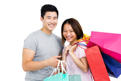 Young couple with shopping bags. Portrait of young couple with shopping bags on white background Stock Photos