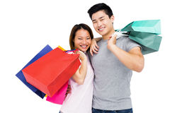 Young couple with shopping bags. Portrait of young couple with shopping bags on white background Stock Images