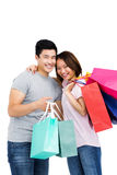 Young couple with shopping bags. Portrait of young couple with shopping bags on white background Stock Photography