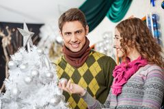 Young Couple Shopping For Christmas Tree Royalty Free Stock Photography