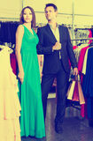 Young  couple shopping in clothing store and enjoying together Royalty Free Stock Photos