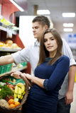 Young couple shopping at groceries. Supermarket: young couple shopping at groceries Royalty Free Stock Images