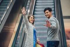 Young couple shopping and holding bags royalty free stock image