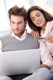 Young couple shopping on internet. Having laptop, using credit card stock photo