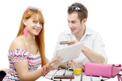 Young couple shopping on internet with tablet Royalty Free Stock Images