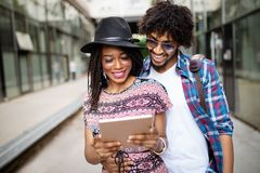 Young couple shopping on internet with tablet stock photography