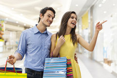 Young couple in shopping mall Royalty Free Stock Photo