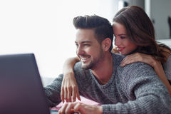 Young couple shopping online at home Royalty Free Stock Photos