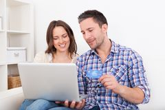 Young couple shopping online Stock Photos