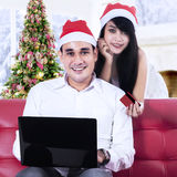 Young couple shopping online Stock Image