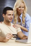Young couple shopping online Stock Images