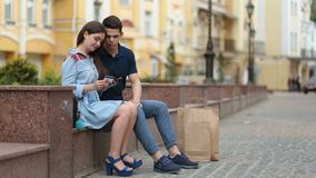 Young couple shopping online using mobile phone stock video footage