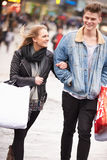 Young Couple Shopping Outdoors Together Royalty Free Stock Photography