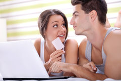 Young couple shopping  over internet Stock Photos