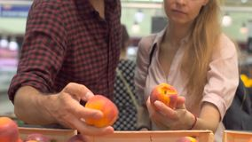 Young couple shopping in a supermarket stock video footage