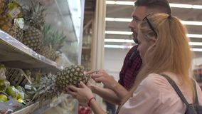 Young couple shopping in a supermarket stock video