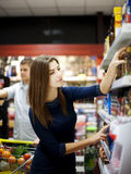 Young couple shopping at supermarket. Supermarket: young couple shopping at supermarket Stock Image