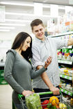Young couple shopping at supermarket Stock Image