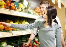 Young couple shopping at supermarket Stock Photos