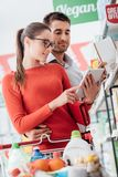 Young couple shopping with a tablet royalty free stock photo
