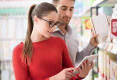 Young couple shopping with a tablet stock image