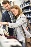 Young couple shopping together for clothes Stock Image