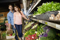 Young couple shopping for vegetables in supermarket Stock Photo