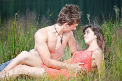 Young couple on the shore Stock Photo