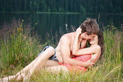 Young couple on the shore Royalty Free Stock Image