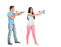 Young couple shouting with megaphones. Isolated on white Royalty Free Stock Photography
