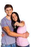 Young couple showing keys to house Royalty Free Stock Photos