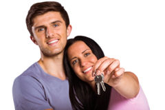 Young couple showing keys to house Royalty Free Stock Images