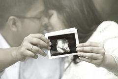 Young couple showing a sonogram Royalty Free Stock Photo