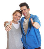 Young couple showing thumbs up. Laughing young couple showing thumb up on an isolated white background Stock Photography
