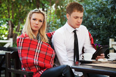 Young couple at a sidewalk cafe Stock Photos
