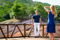 Young couple sightseeing Chamarel coloured earths Royalty Free Stock Images