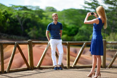 Young couple sightseeing Chamarel coloured earths Royalty Free Stock Photo
