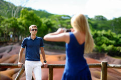Young couple sightseeing Chamarel coloured earths Stock Images