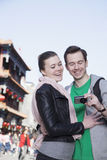 Young couple sightseeing, looking at digital camera. Stock Photography