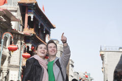 Young couple sightseeing, looking and pointing. Royalty Free Stock Image