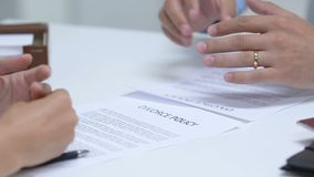 Young couple signing divorce policy, taking off engagement rings from fingers. Stock footage stock footage