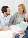 Young couple signing property purchase contract Stock Photo